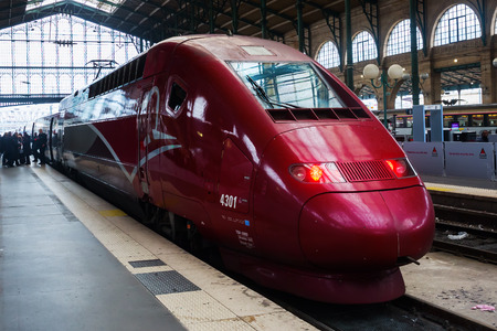Paris, France - October 21, 2016: Thalys train and unidentified people at the station Gare du Nord in Paris. The Thalys is an European high-speed train with a speed up to 300 km/h. Editoriali