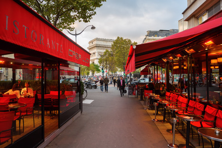 Paris, France - October 20, 2016: street cafe with unidentified people in Paris. Paris is the capital of France and one of Europes major centres of finance, commerce, fashion, science, and the arts