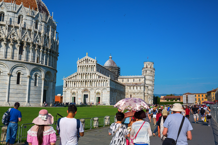 Pisa, Italy - June 30, 2016: The Leaning Tower of Pisa with unidentified people. The Tower of Pisa is the campanile of the cathedral of Pisa, known worldwide for its unintended tilt. Editorial