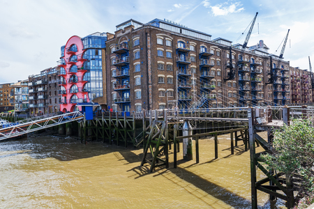 concordia: London, UK - June 15, 2016: New Concordia Wharf in Southwark, London. It was formerly a late Victorian grain warehouse, today grade II listed, restored and converted into loft apartments Editorial