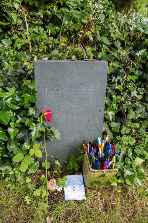 douglas: London, UK - June 18, 2016: tomb of Douglas Adams at the Highgate Cemetery in London. Douglas Adams was an English author, best known for The Hitchhikers Guide to the Galaxy. Editorial