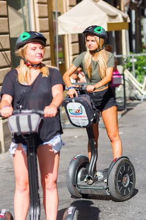Florence, Italy - July 04, 2016: unidentified tourists with Segway in Florence. The Segway PT is a two-wheeled, self-balancing, battery-powered electric vehicle popular for tourist use in big cities