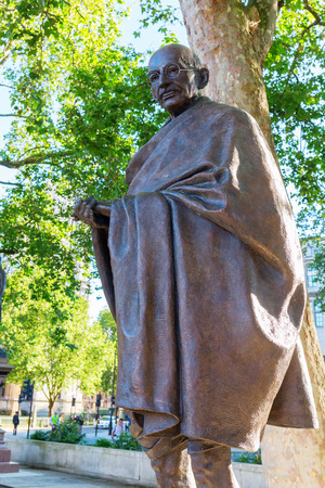 mahatma: London, UK - June 20, 2016: bronze statue of Mahatma Gandhi in London. Gandhi led India to independence and inspired movements for civil rights and freedom across the world.