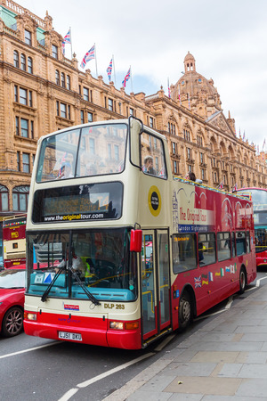 London, UK - June 21, 2016: bus in front of Harrods in London, with unidentified people. It is the best known department store of London.