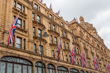 facade of the department store Harrods in London, UK