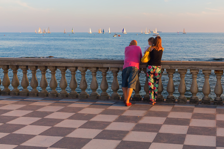 Livorno, Italy - July 01, 2016: Terrazza Mascagni with unidentified people. Its a wide sinuous belvedere toward the sea with a paving surface of 8700 sqm like a checkerboard and 4,100 balusters Editorial