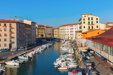 seaports: Livorno, Italy - July 01, 2016: picturesque district Venezia Nuova in Livorno. Livorno is a port city on the Ligurian Sea with one of the largest seaports in the Mediterranean Sea