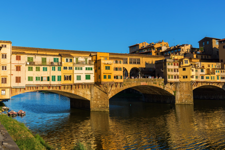 river arno: the famous Ponte Vecchio over river Arno in Florence, Italy