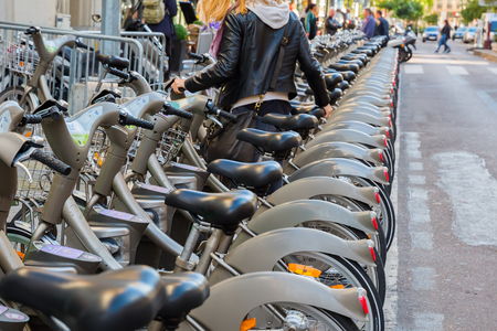 france station: Paris, France - October 15, 2016: Velib bicycle station. Its a large-scale public bicycle sharing system, encompassing around 14,500 bicycles and 1,230 stations, it was launched on 15 July 2007