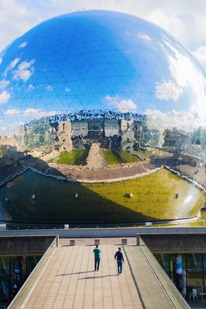 Paris, France - October 15, 2016: La Geode in the Parc de la Villette with unidentified people. Its a mirror-finished geodesic dome with an Omnimax theatre at the Cite des Sciences et de l Industrie