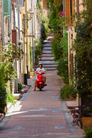 maritimes: Antibes, France - July 24, 2016: alley in the old town of Antibes with unidentified person. Antibes is a Mediterranean resort in the Alpes-Maritimes department of southeastern France, on Cote d Azur