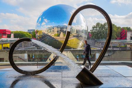 gravitation: Paris, France - October 15, 2016: anti gravitation sculpture at the Cite des Sciences et de l Industrie in the Parc de la Villette with unidentified person. It is the biggest science museum in Europe Editorial