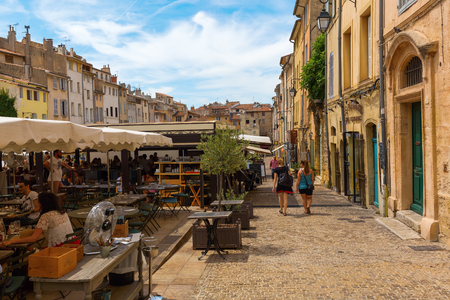 Aix-en-Provence - July 27, 2016: Place des Cardeurs with several cafes and unidentified people in Aix-en-Provence. Aix-en-Provence is University city and the historical capital of the Provence. Editorial