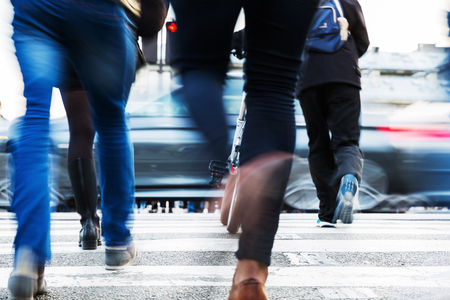 hurried: hurried people in motion blur crossing a city street Stock Photo