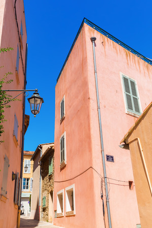 tropez: typical pastel colored houses in Saint Tropez, French Riviera, France
