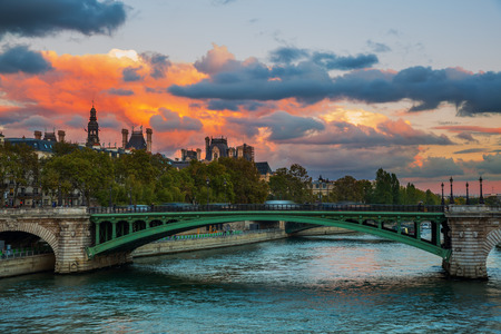 ile de la cite: Seine bridge in Paris, France, with dramatic evening sky Stock Photo