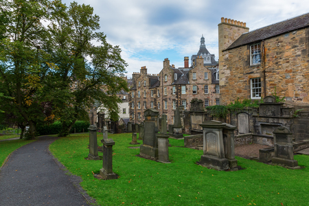 guarded: Edinburgh, Scotland - September 09, 2016: Greyfriars Kirkyard in Edinburgh. The heritage listed graveyard is associated with Greyfriars Bobby, a loyal dog, who guarded his masters grave for years Editorial