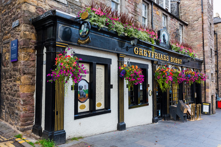 guarded: Edinburgh, Scotland - September 09, 2016: pub at the Greyfriars Kirkyard. The The name Greyfriars Bobby is dedicated to a loyal dog, who guarded his masters grave for years