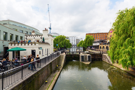canal lock: London, UK - June 17, 2016: Camden Lock with unidentified people. It is a part of Camden Town, which was formerly a wharf with stables on the Regents Canal. It is a twin manually operated lock Editorial