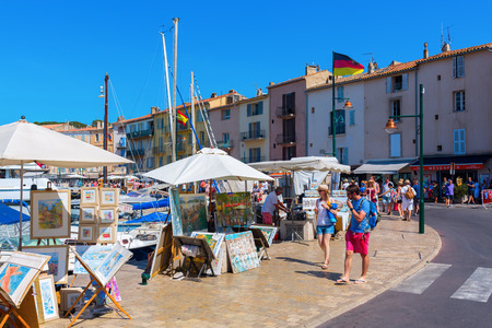 Saint Tropez, France - August 03, 2016: view at the harbor of Saint Tropez with unidentified people. St Tropez is a seaside resort at the Cote dAzur and popular for the European and American jet set