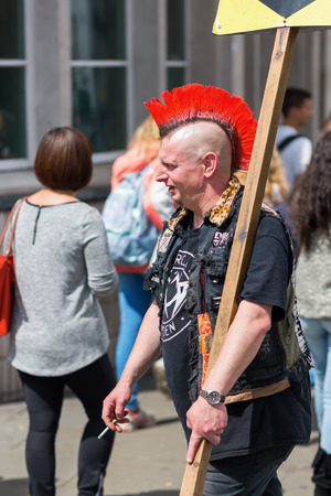 subculture: London, UK - June 17, 2016: typical hairstyle of a punk in Camden, London. The punk subculture is largely characterized by anti-establishment views and the promotion of individual freedom. Editorial