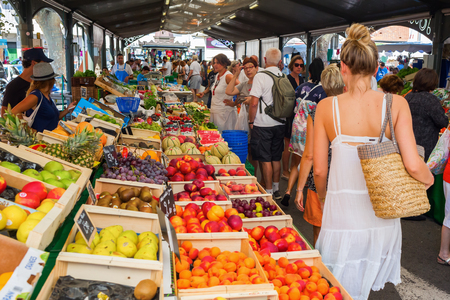 street market: Cannes, France - August 05, 2016: Provencal market in Cannes with unidentified people. Cannes is well known for its association with the rich and famous, and the Cannes Film Festival Editorial