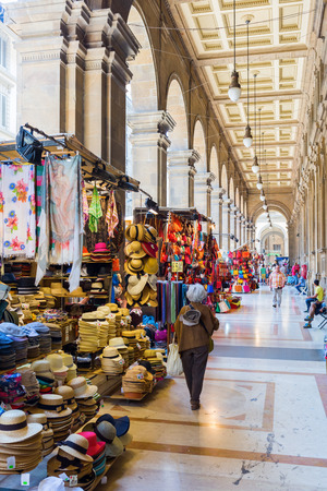 arcades: Florence, Italy - July 06, 2016: arcades beside the Piazza Repubblica in Florence with undientified people. In medieval time Florence was the center of European trade and one of the wealthiest cities