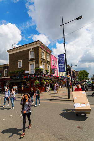 venues: London, UK - June 17, 2016: street scene in Camden with unidentified people. The area hosts street markets and music venues which are strongly associated with alternative culture
