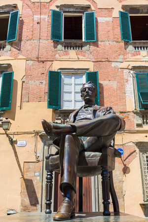 verdi: Lucca, Italy - July 01, 2016: statue of Giacomo Puccini in front of his birthplace in Lucca. He was an Italian opera composer who has been called -the greatest composer of Italian opera after Verdi-
