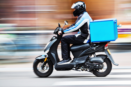 picture of a scooter delivery service in motion blur
