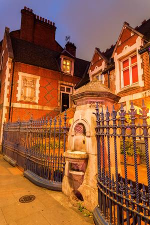 hamlets: old drinking fountain at Brick Lane in Tower Hamlets, London, UK, at night