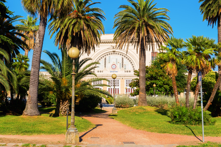 livorno: central station of Livorno, Italy, with a palm park in front Stock Photo
