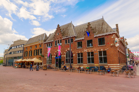 Arnhem, Netherlands - April 19, 2016: historic building in the city center of Arnhem with unidentified people. Arnhem is the capital of the province of Gelderland with a population of about 150,000