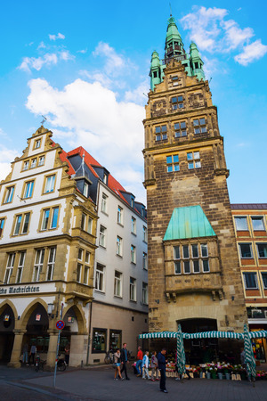 Muenster, Germany - September 25, 2016: city hall tower with unidentified people. Muenster is well known as bicycle city and for the after WW I partly restored historical old town