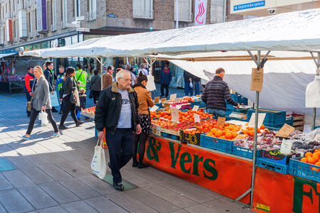 Eindhoven, Netherlands - April 12, 2016: street market in the city center with unidentified people. With about 225,000 inhabitants its the 5th-largest municipality of Netherlands