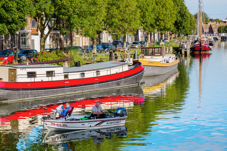 Enkhuizen, Netherlands - October 09, 2016: canal scene in Enkhuizen, with unidentified people. Enkhuizen has today one of the largest marinas in the Netherlands