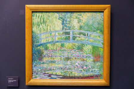 monet: Paris, France - October 19, 2016: painting of Claude Monet in the Musee dOrsay, Paris. It houses in the former Gare dOrsay, a Beaux-Arts railway station. It is one of the largest museums in Europe