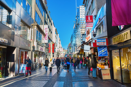 Cologne, Germany - December 30, 2016: shopping street Hohe Strasse with unidentified people. It is a shopping street in the old town and one of citys both oldest and busiest streets