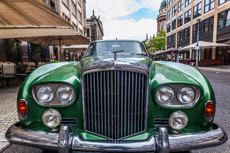 motorcars: Berlin, Germany - May 15, 2016: Bentley car on a street in Berlin. Bentley Motors Limited is a British company that designs, develops, and manufactures luxury motorcars which are largely hand-built Editorial