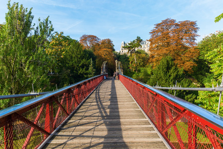 Paris, France - October 15, 2016: bridge from Temple de la Sibylle in the Parc des Buttes Chaumont, with unidentified people. It is the 5th larges park in Paris, opened 1867