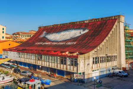 seaports: Livorno, Italy - July 01, 2016: fish market hall in the district Venezia Nuova in Livorno. Livorno is a port city on the Ligurian Sea with one of the largest seaports in the Mediterranean Sea Editorial