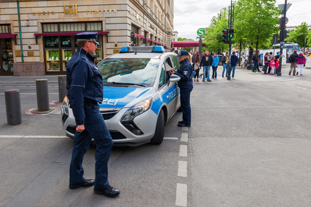 Berlin, Germany - May 14, 2016: police car in Berlin with unidentified people. Berlin, capital of Germany, has about 3.5 mio inhabitants and is a global city of culture, politics, media, sciences