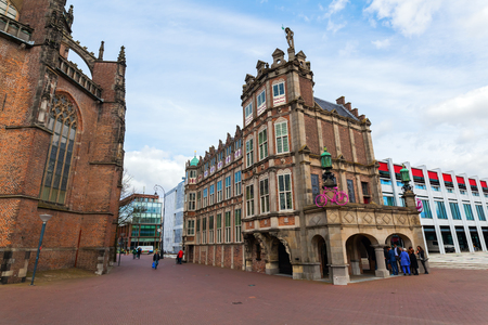 Arnhem, Netherlands - April 19, 2016: historical devil house with unidentified people. It is a Renaissance building from 1538 and houses today a part of the city hall