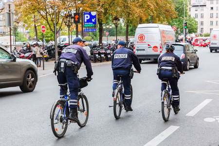 Paris, France - October 19, 2016: bicycle-mounted police in Paris. Paris with over 2 mio inhabitants is the largest city in France and one of the most important cities of the western world.