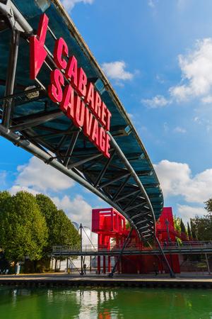 Paris, France - October 15, 2016: bridge with advertisement in the Parc de la Villette. Its the 3rd-largest park in Paris that houses one of the largest concentration of cultural venues in Paris