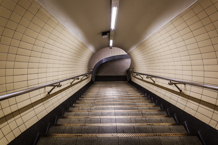 france station: pedestrian tunnel with stairs of the Metro of Paris, France