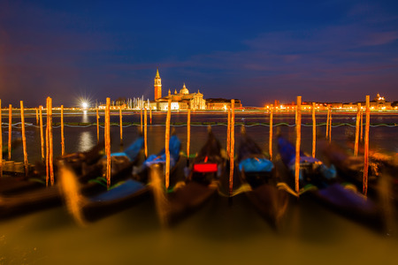 stakes: picture of gondolas in Venice, Italy, at night