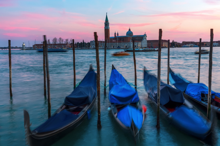 picture of gondolas in Venice, Italy, at dusk