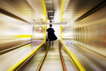 man walking downstairs in an underground station with creative zoom effect