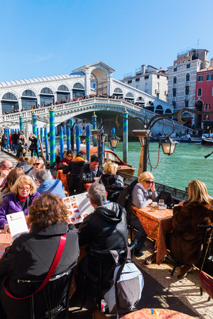 Venice, Italy - February 25, 2017: Rialto Bridge at the Grand Canal with unidentified people. Venice is world renown for the beauty of its settings Editorial
